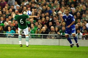 Glen Whelan controls the ball on his chest as Sergio Moreno Marin watches on