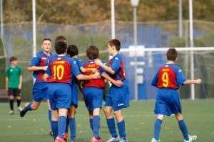 Infantil del CDB Almantour durante la celebración de un gol